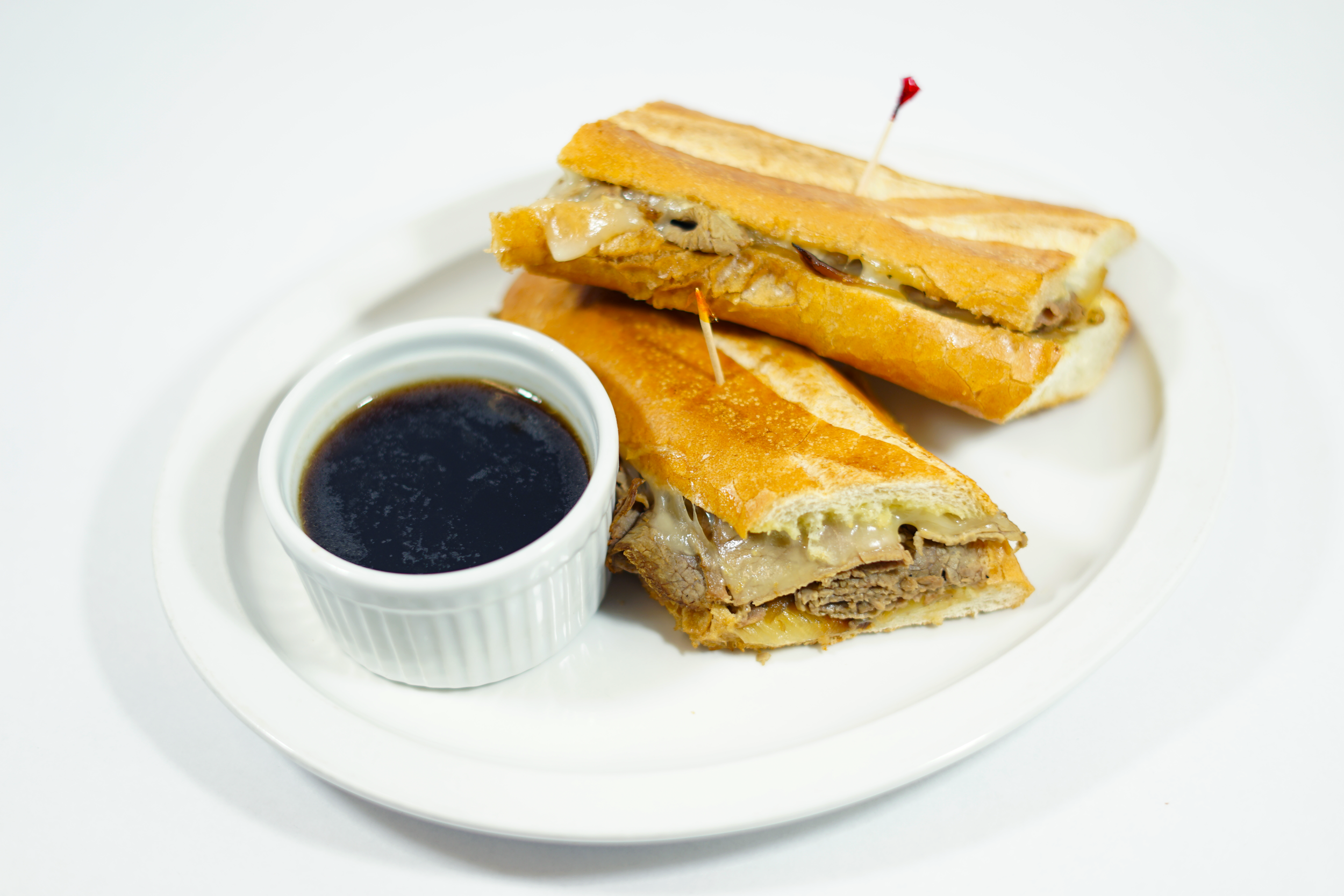 French Dip - Freshly prepared eye of round beef on a Baguette with caramelized onions, dijon mayo spread and provolone cheese. A side of au jus to dip.