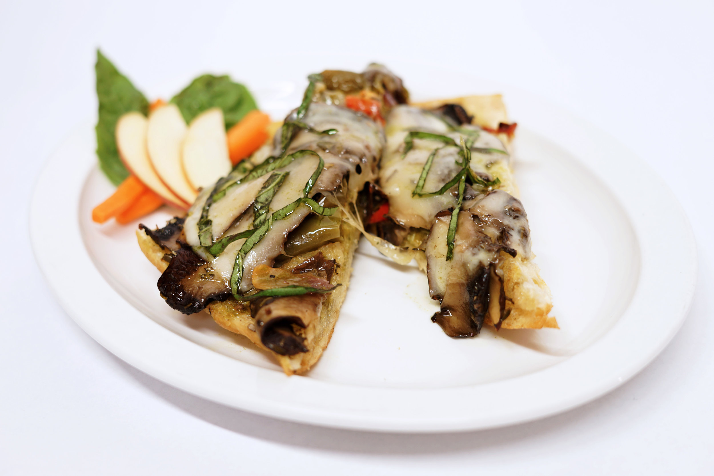 Portabella Mushroom - An oven toasted, open face sandwich on Foccacia bread with marinated portabella mushroom, pesto mayo, roasted bell peppers, and melted provolone cheese. Garnished with chopped basil and drizzle of pesto oil.