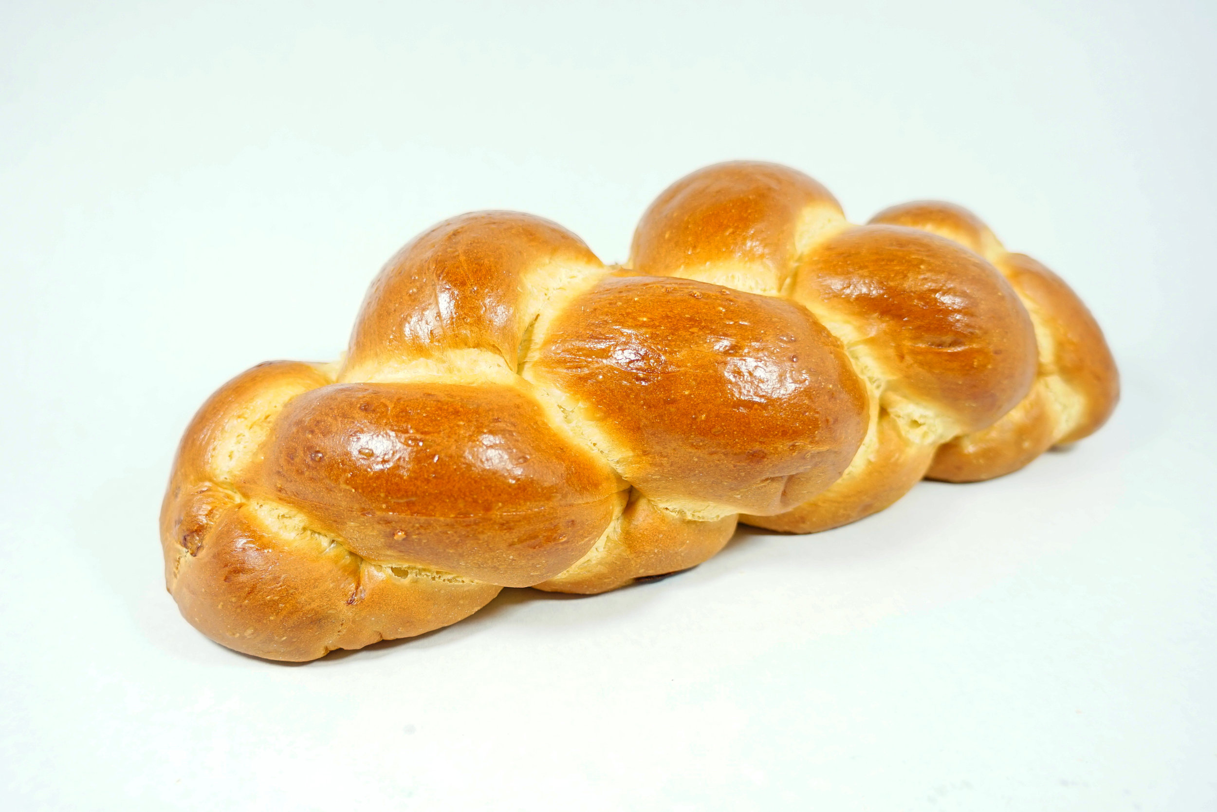 Challah - Our braided loaf topped with sesame, poppy or mixed seeds. You have a choice to order raisins baked inside. Makes a great French toast or sandwiches.*Every Friday