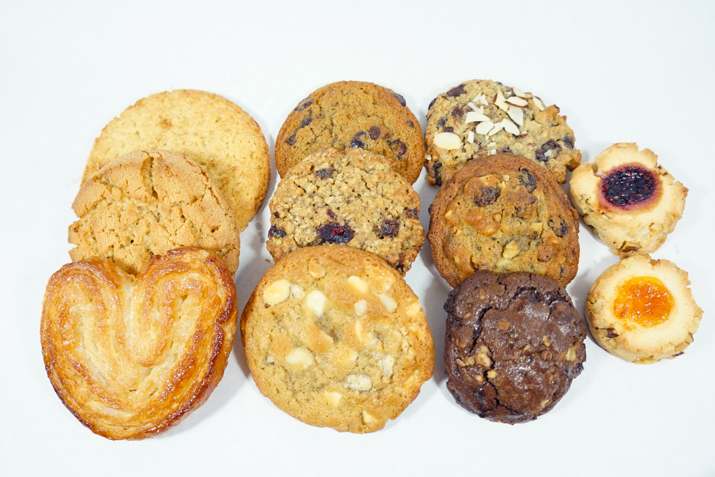 Cookies - White Chocolate Macadamia, Chocolate Chip, Double Chocolate with Walnuts, Raisin Walnut, Oatmeal Chocolate Chip, Cranberry Oatmeal, Snickerdoodle, Peanut Butter, Palmier, Thumbprint, or Pecan Sandie