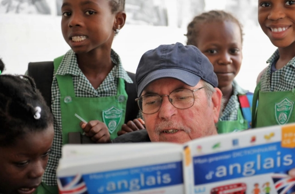 John tried to get the kids to teach me French. (Photo by John Dear)