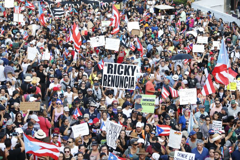 "Photo credit of opening image: Thousands of demonstrators protesting against Ricardo Rossello, the Governor of Puerto Rico July 17, 2019 in front of the Capitol Building in Old San Juan, Puerto Rico. The sign reads ""Ricky Resign."" (Photo:    Jose Jimenez/Getty Images   )"