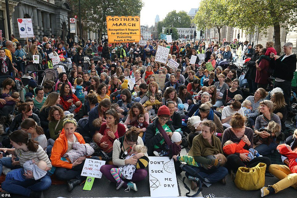 Photo Credit: Extinction Rebellion UK's nurse-in calling attention to the peril all babies are facing due to the climate crisis. Photo by    Marc Duell, Daily Mail.