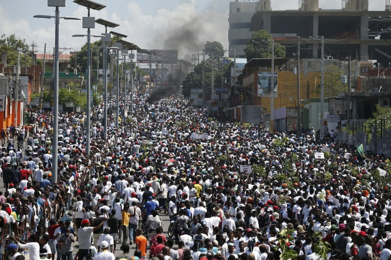 Photo Credit: Protesters in Port Au Prince, Haiti. Photo by    Rebecca Blackwell, AP   .
