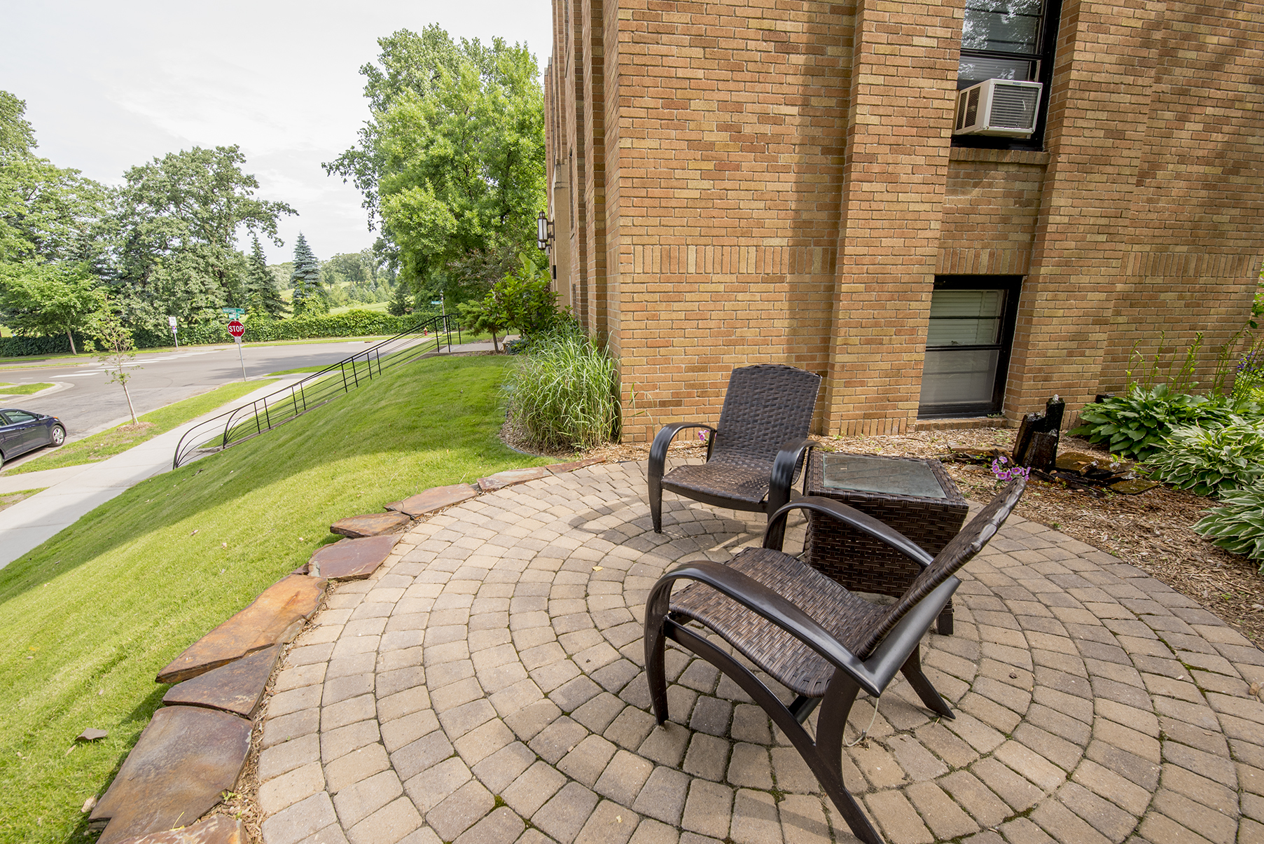 A perfect spot to enjoy some time outside - a small water feature and a comfortable patio is available for our residents to enjoy.