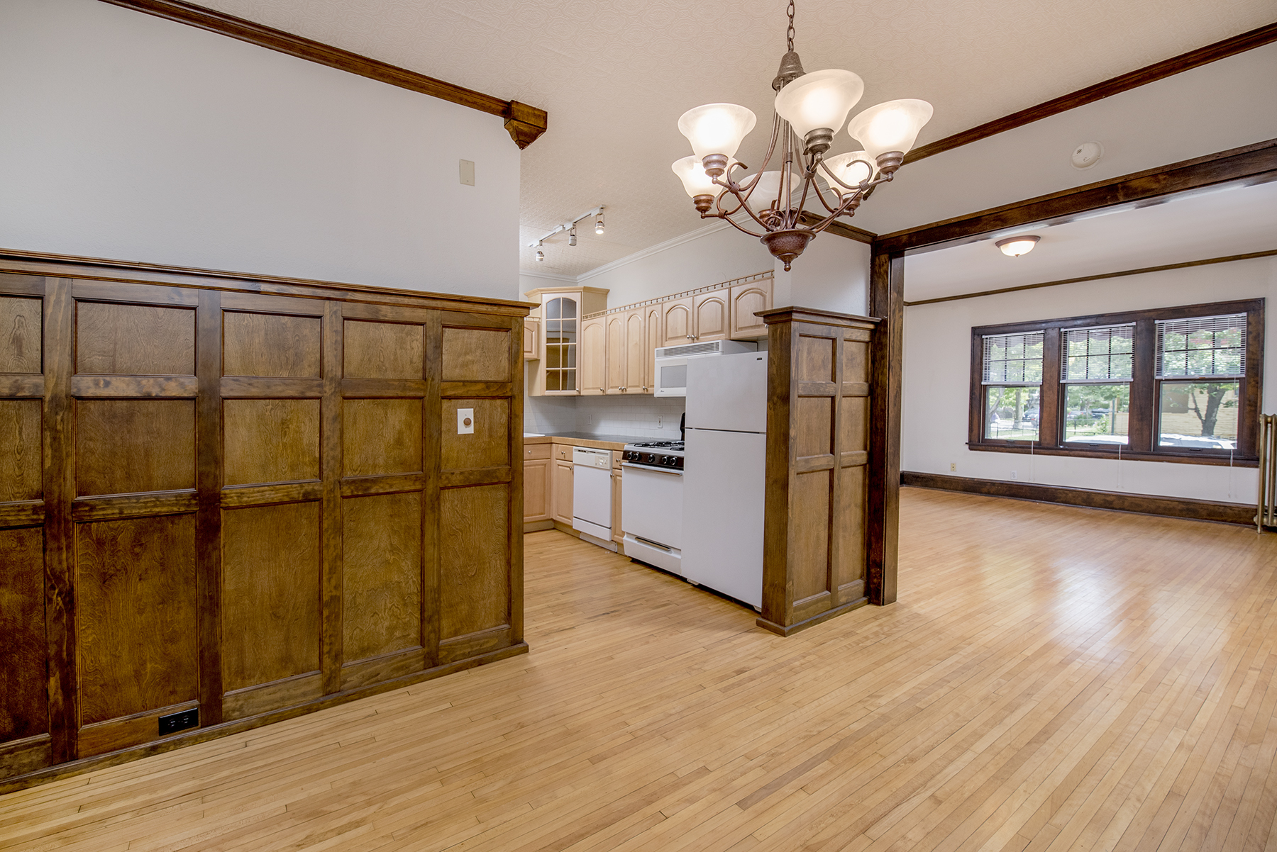 Beautifully restored wood paneling is original to the building's construction.