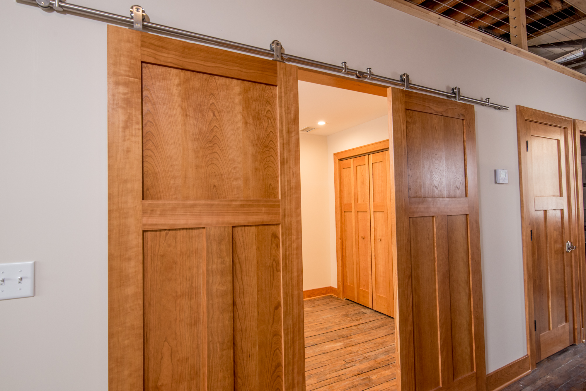 Barn doors offer full privacy in some of the building's units