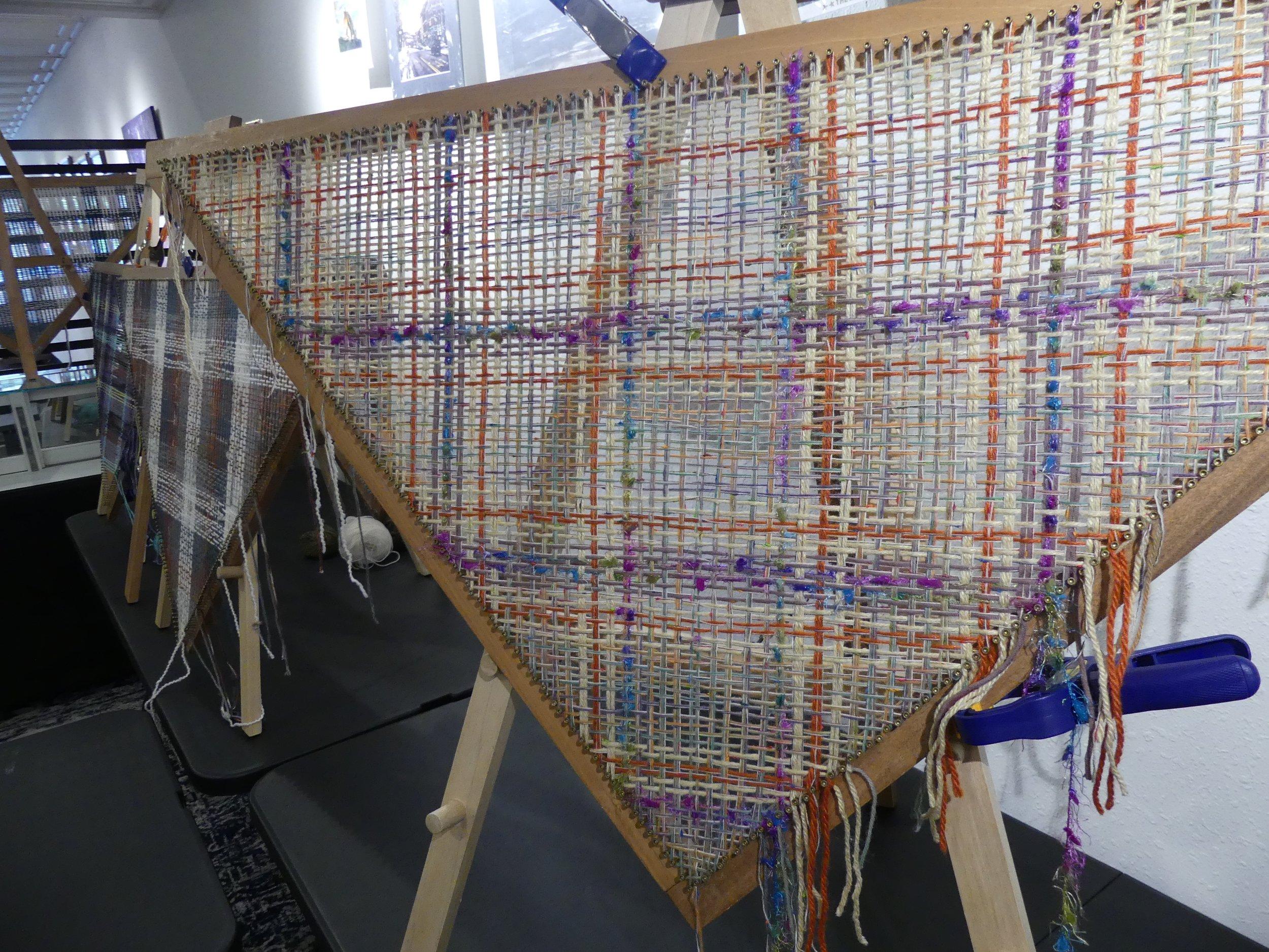 Wraps in progress on a triangle loom.