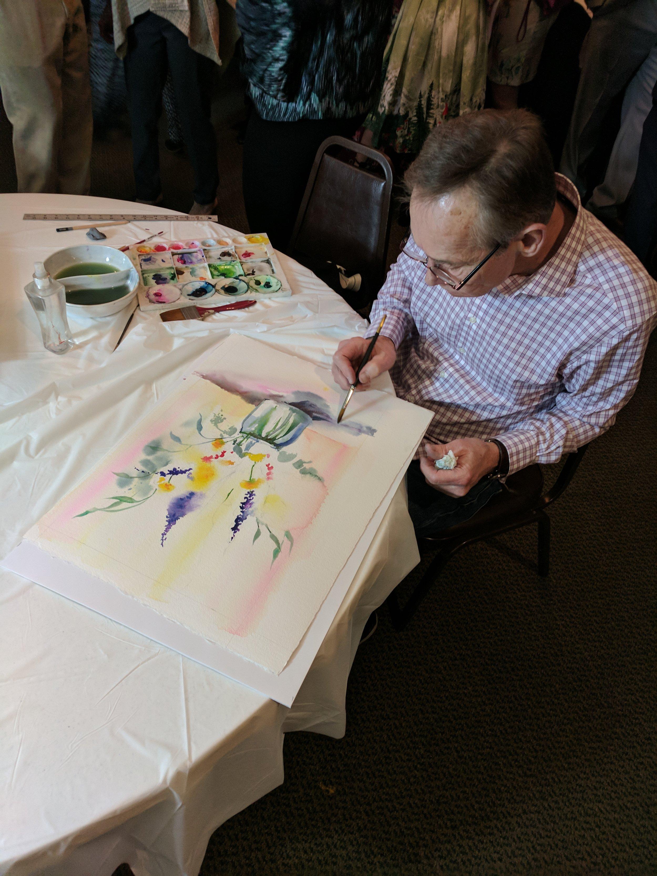 Pete Winklbauer paints a live auction piece at the Annual Gala Fundraiser.
