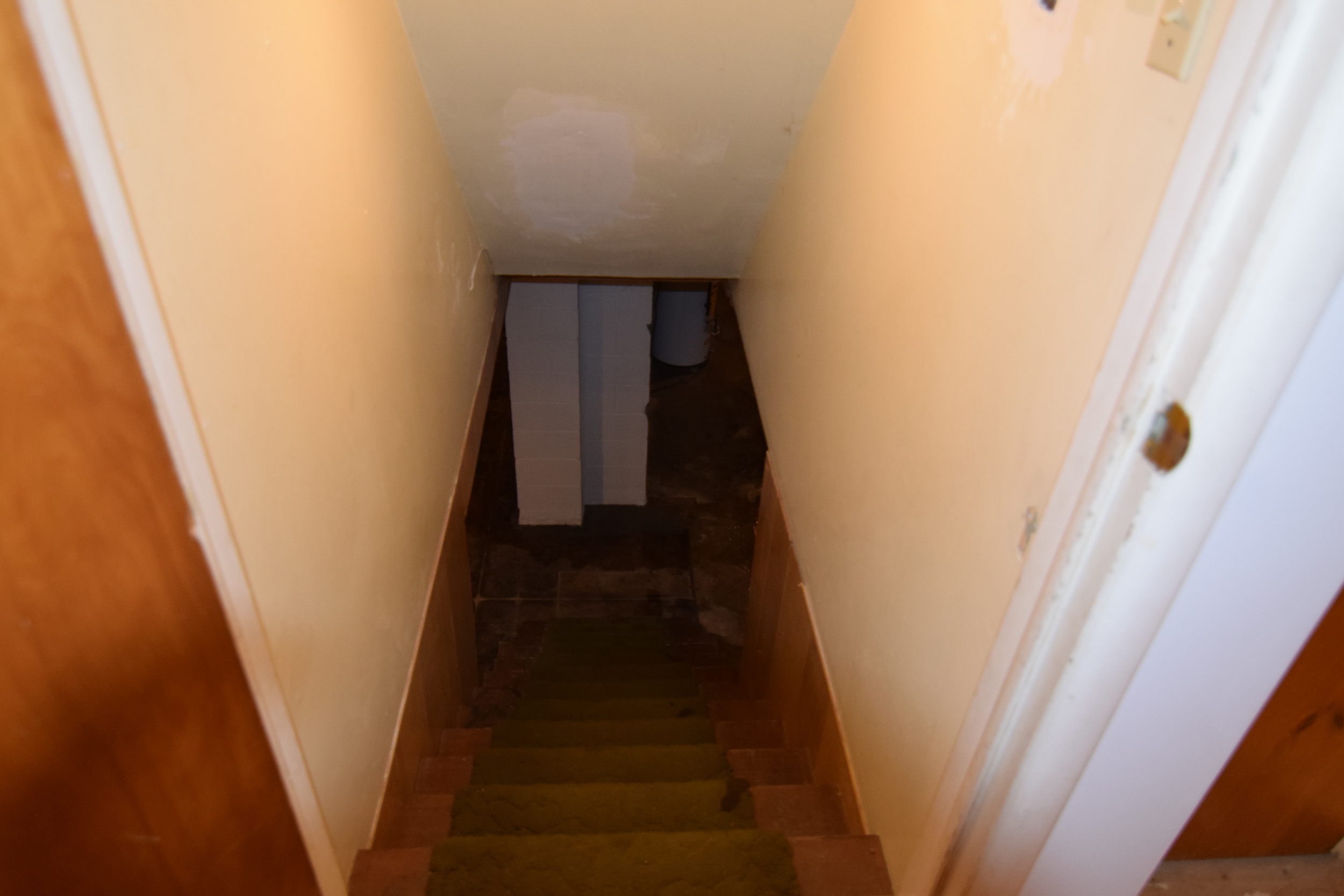 Monarch Homes | The House Next Door | Basement Stairs - Before