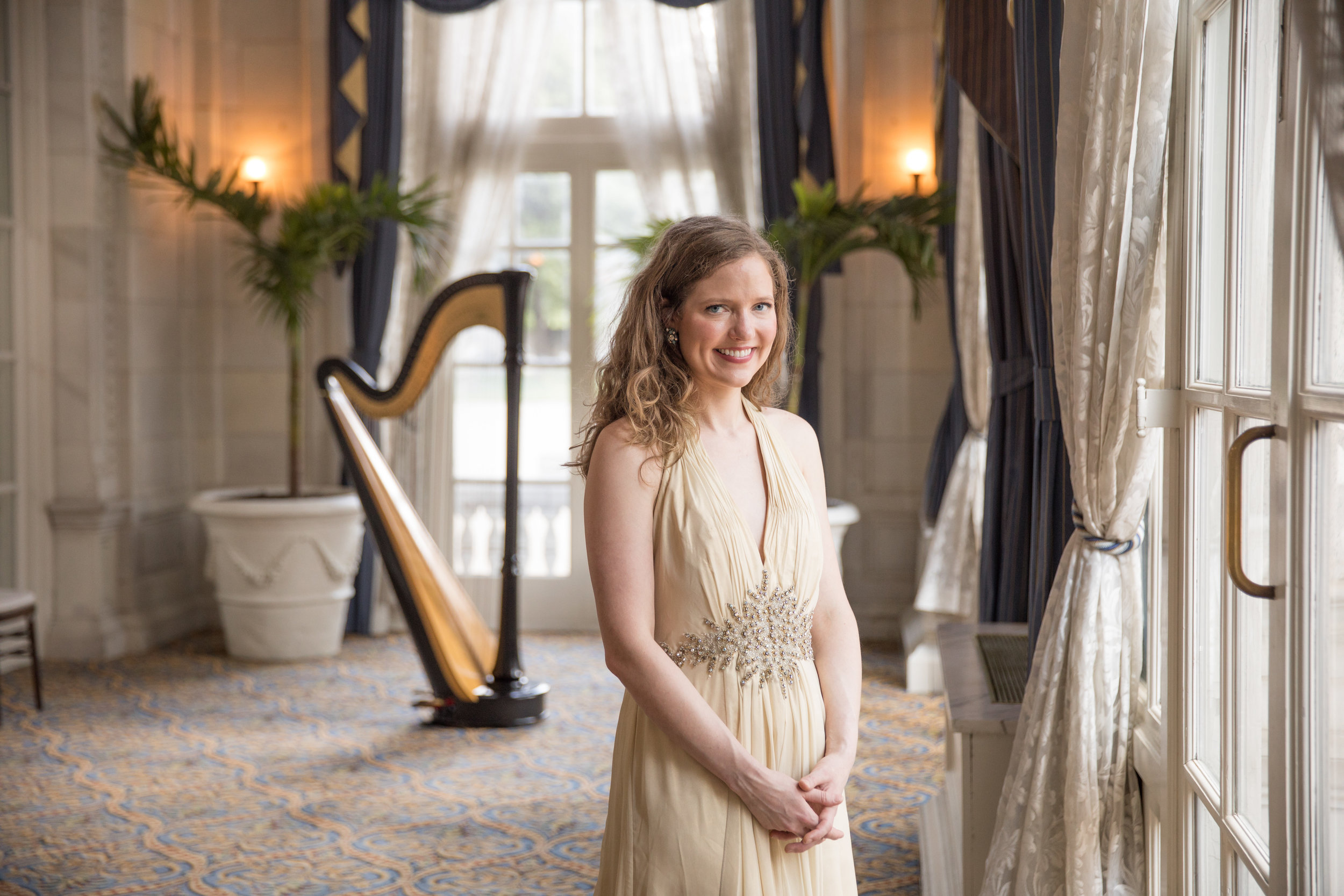 Hi, I'm Dr. Agnes Bartek- - Founder and owner of The Harp Salon. I help elegant brides, like you, create the romantic wedding of their dreams by providing beautiful harp music for their wedding ceremony.