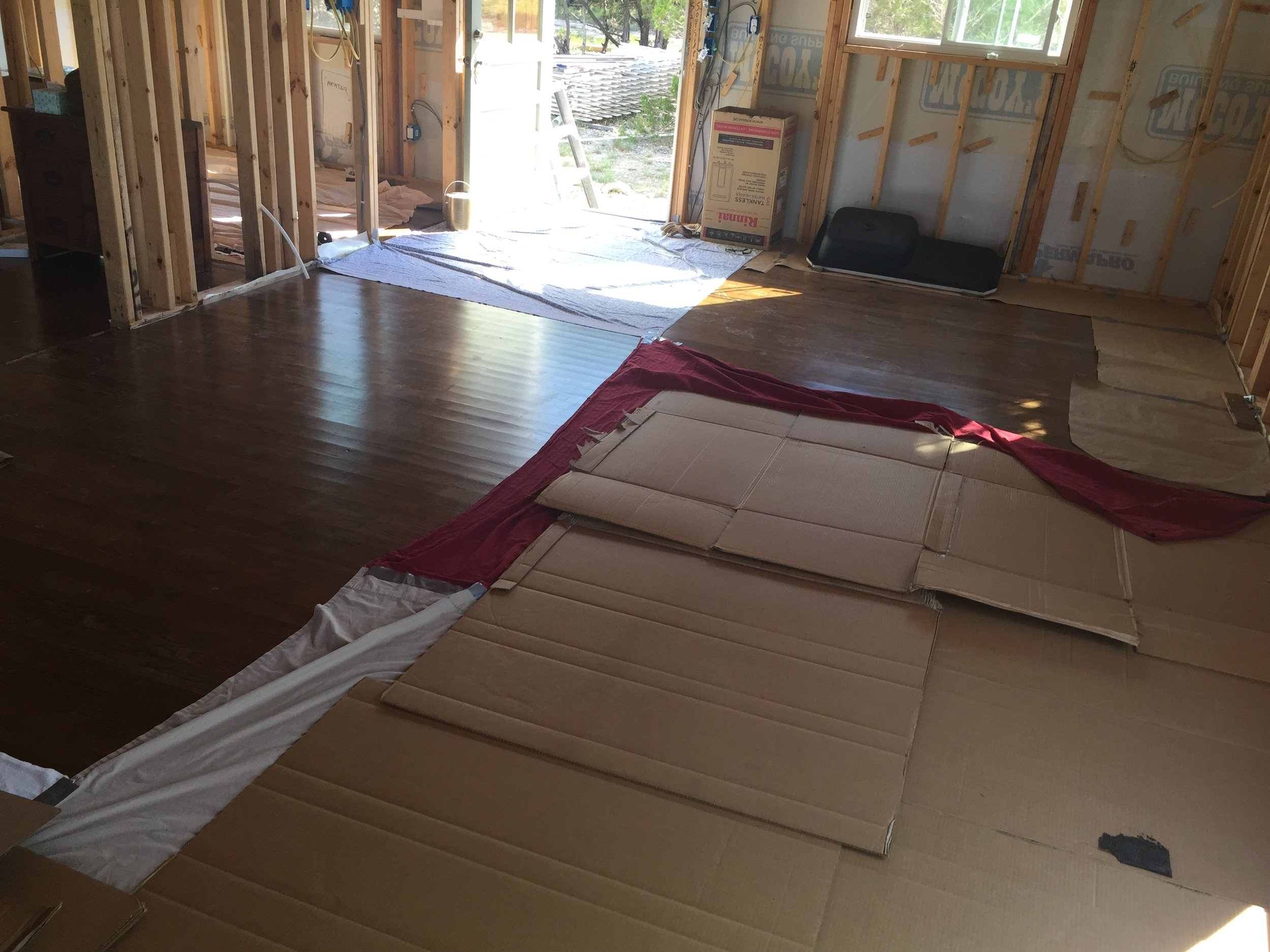We covered the hardwood flooring with sheets and cardboard
