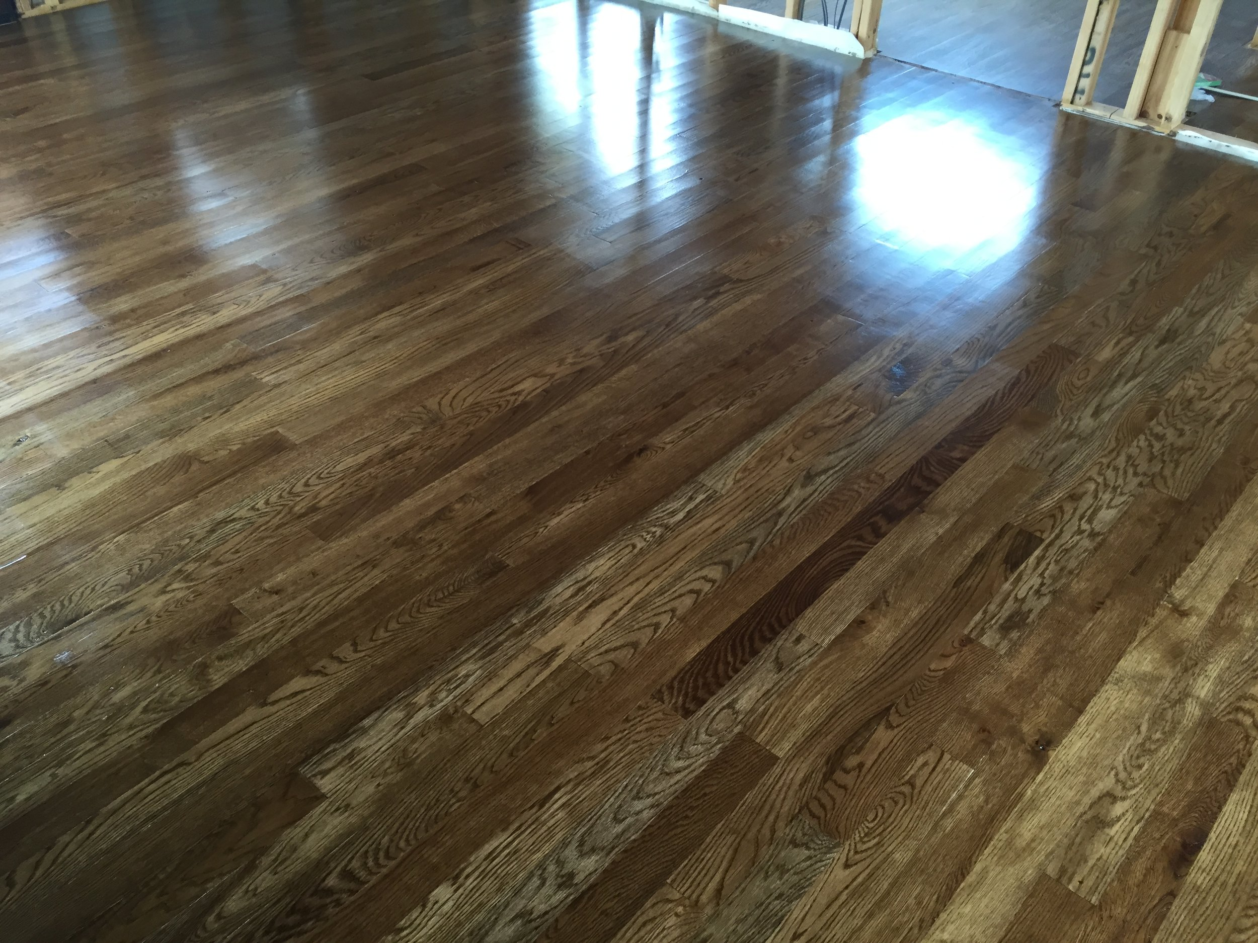Hardwood flooring installed, stained and sealed