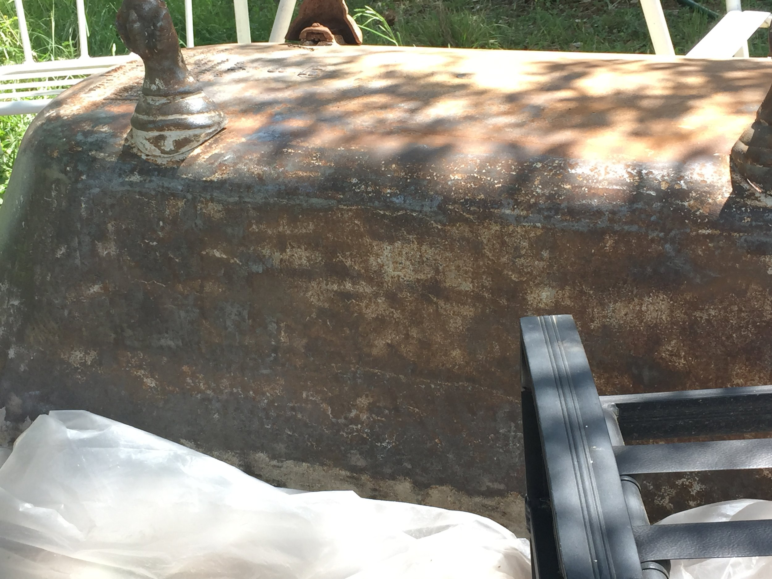Sanding on the clawfoot tub-final sand