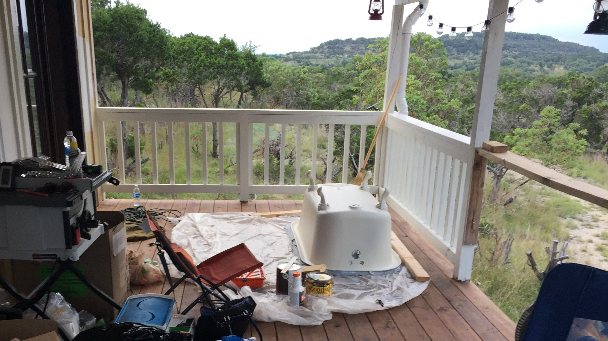 The clawfoot tub on our back porch, covered from the elements. It stayed on the porch about 2 months before we were ready to install it.  Once we were finally ready for the install, it ended up looking like this:
