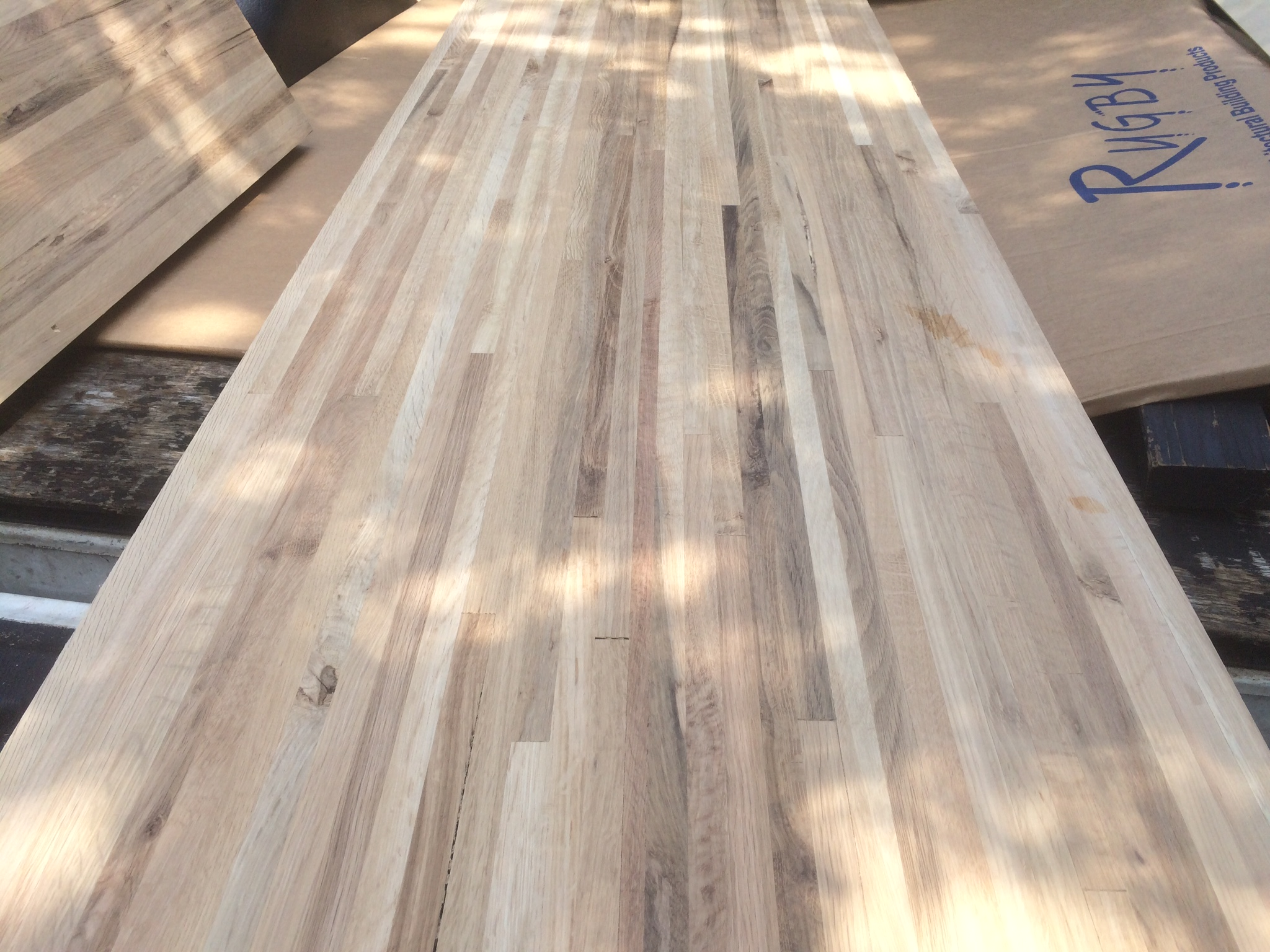 The wood countertops after planing and sanding-loaded in the bed of the truck