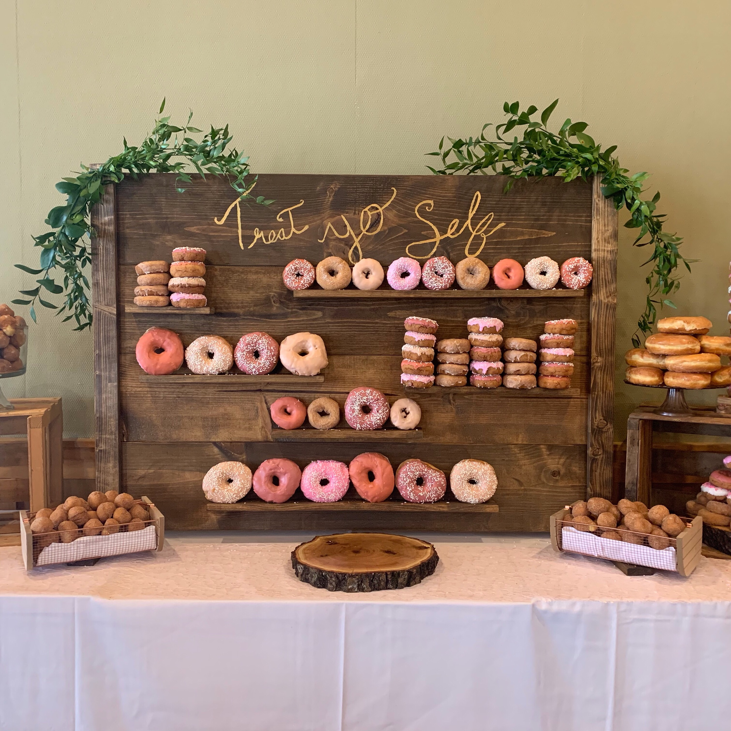 Customized Dessert Wall - You can customize the top sign to say whatever you want! 4x4 structure can fit donuts, dessert shooters, cupcakes and more! We also have cake stands to create a complete look.  $75 for the wall (includes delivery, set up and tear down with in 25 miles of Minneapolis) Outside of that add a delivery fee $25-$50  add $25 to customize the signage  add $25 for extra cake stands