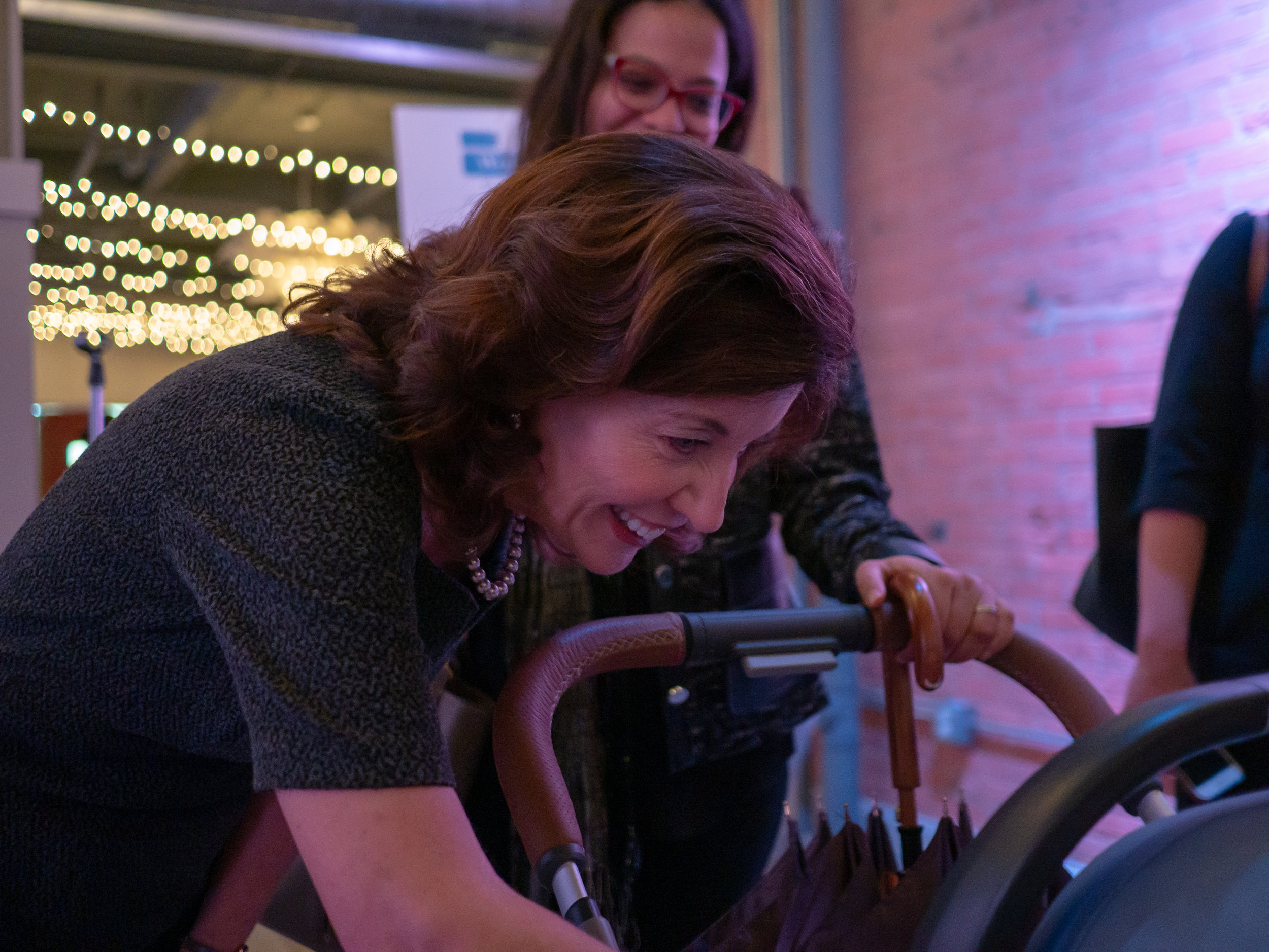 Kathy Hochul smiling at baby in a stroller