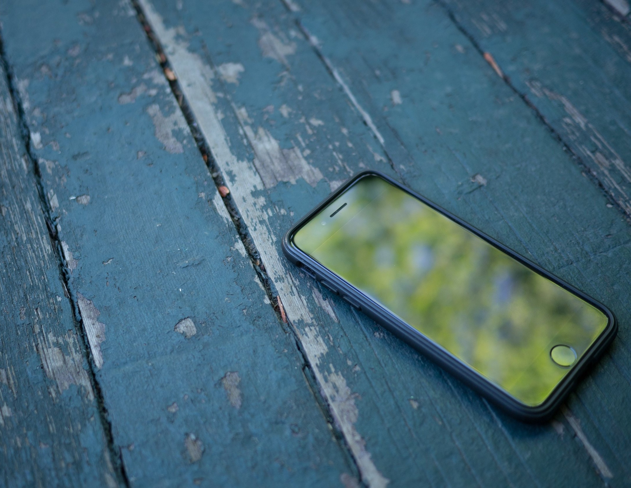 iPhone on a blue wooden floor