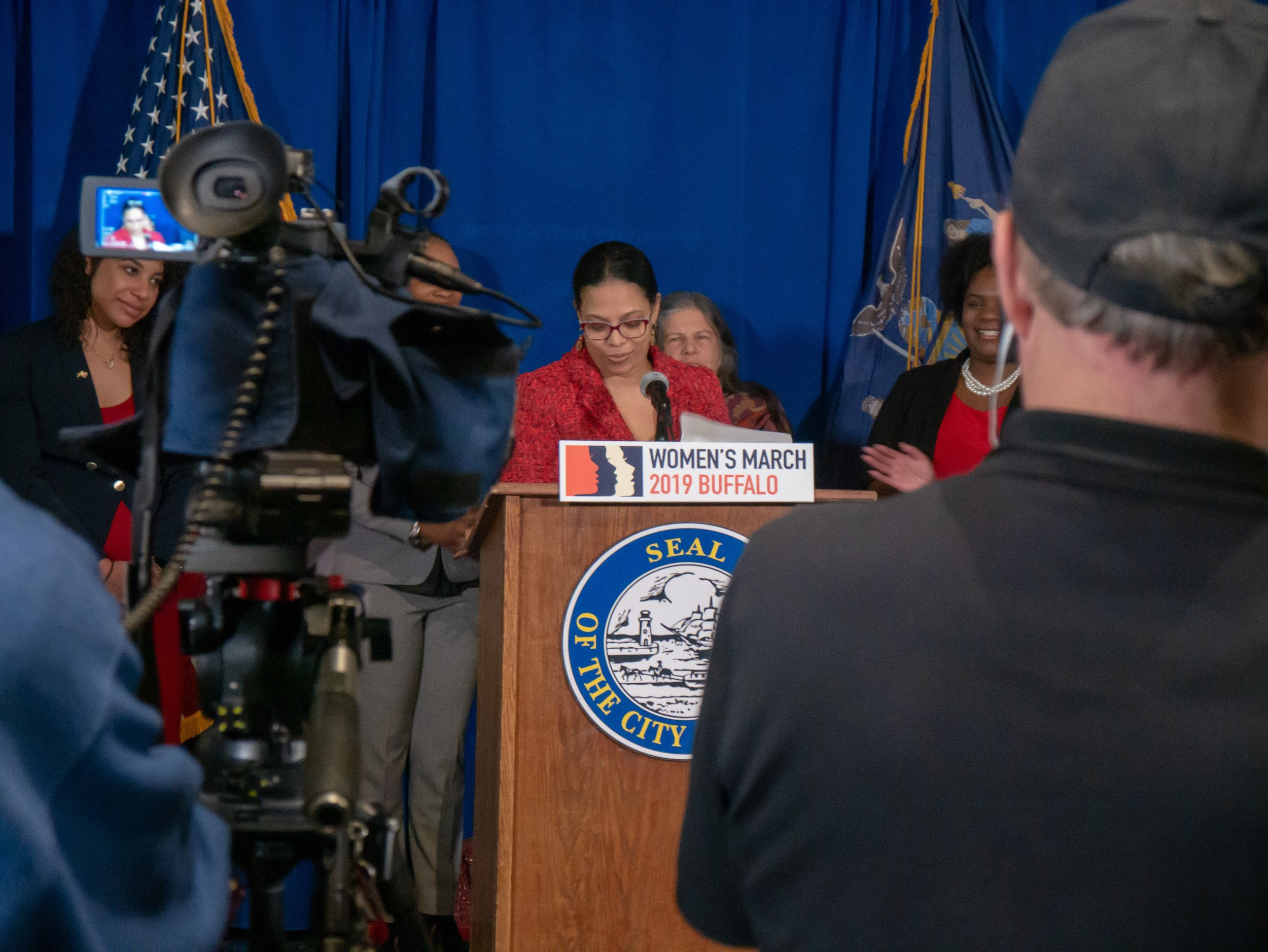 Woman politician at a press conference in front of cameras