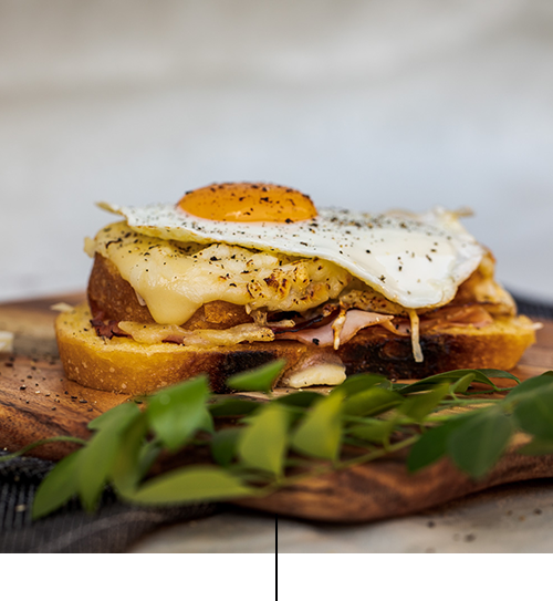 "Croque Madame   Grilled sandwich with ham off the bone, melted emmental cheese, creamy bechamel (milk, egg, flour, emmental cheese) with ""Truffle paste"" Dijon mustard, sunny side up egg"