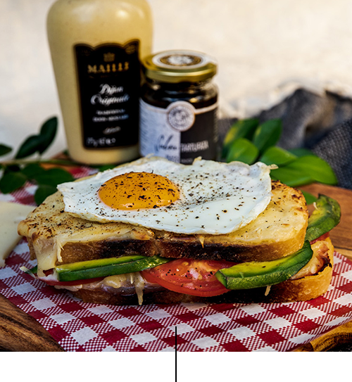 "Croque gourmet   Grilled sandwich with ham, melted emmental cheese, creamy béchamel (milk, egg, flour, emmental cheese) with ""Truffle paste"" Dijon mustard, egg, tomato and avocado"