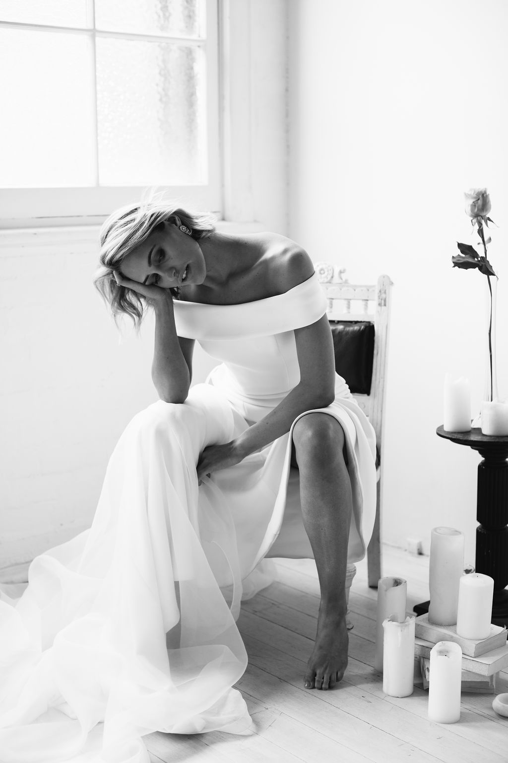 Black and white only bride before wedding on chair moody fashion wedding photography for Amelie George Campaign