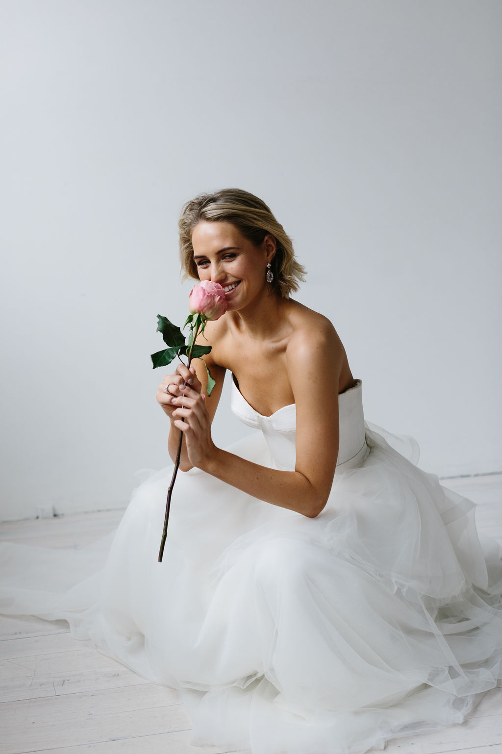 Perfect bride with single rose boutique in strapless wedding dress for Amelie George Campaign