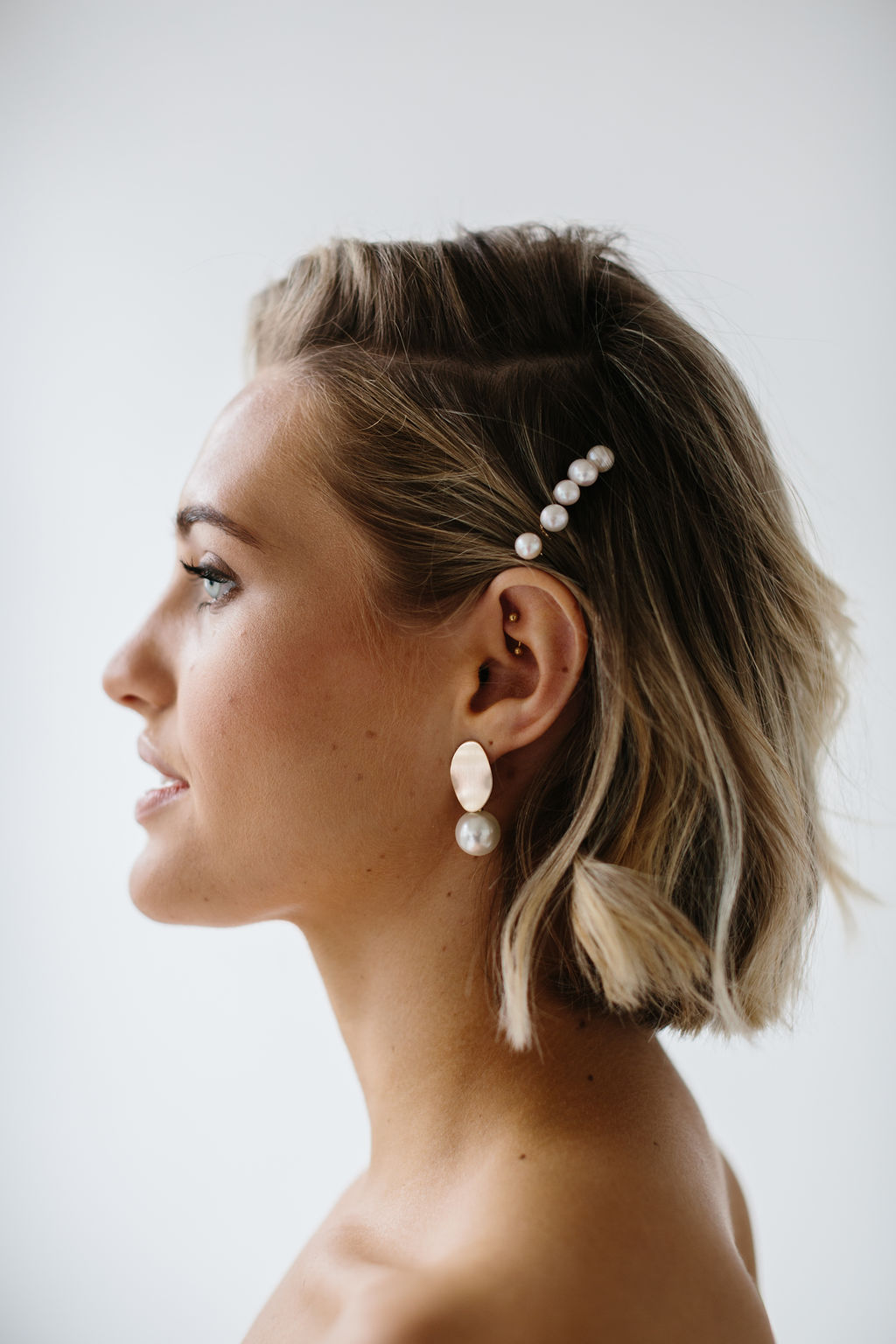 Freshwater Pearl Hair Pins for Wedding and Simple Gold Pearl Drop Bridal Earrings on stunning bride for Amelie George Campaign