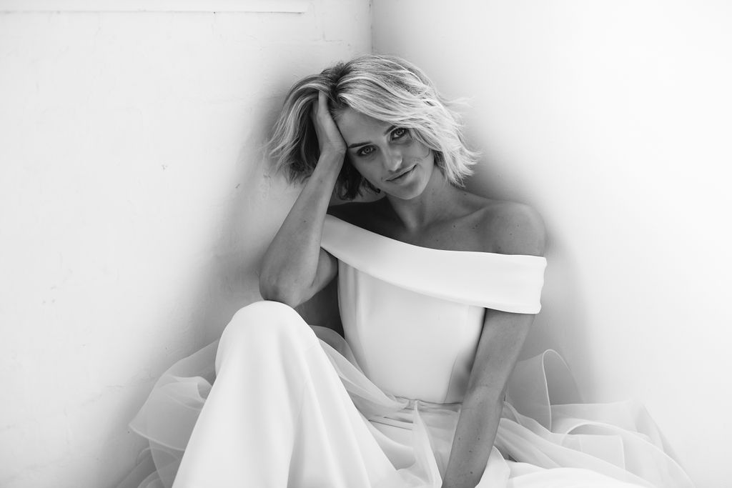 Black and white only photography on pinterest of bride in offshoulder dress in corner for fashion wedding modern hairstyle photo in Amelie George Campaign