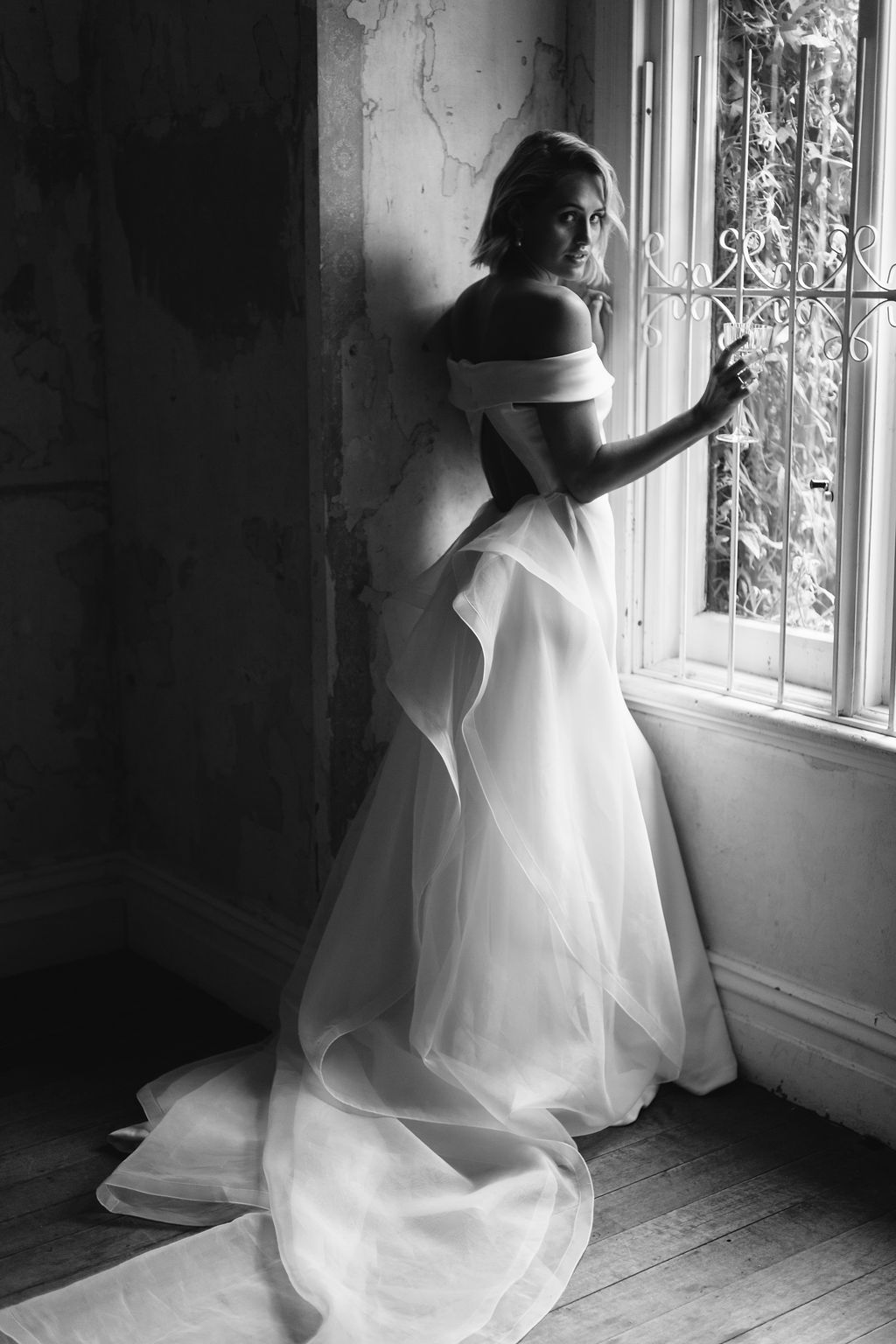 AMELIE GEORGE CAMPAIGN NATURAL BRIDE IN OLD VINTAGE BALLROOM WINDOW WITH WEDDING DRESS WITH TUELLE SKIRT IN BLACK AND WHITE ONLY