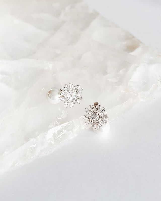 ST CLAIR -  These stunning, drop earrings are a modern take on traditional wedding jewellery. A shimmery crystal starburst, gently clasps a pearl dropper for a bold and playful yet refined look.  Ladies, these are selling fast!  @AmelieGeorgeBridal #AmelieGeorgeBridal #STCALIRAmelieGeorgeBridal