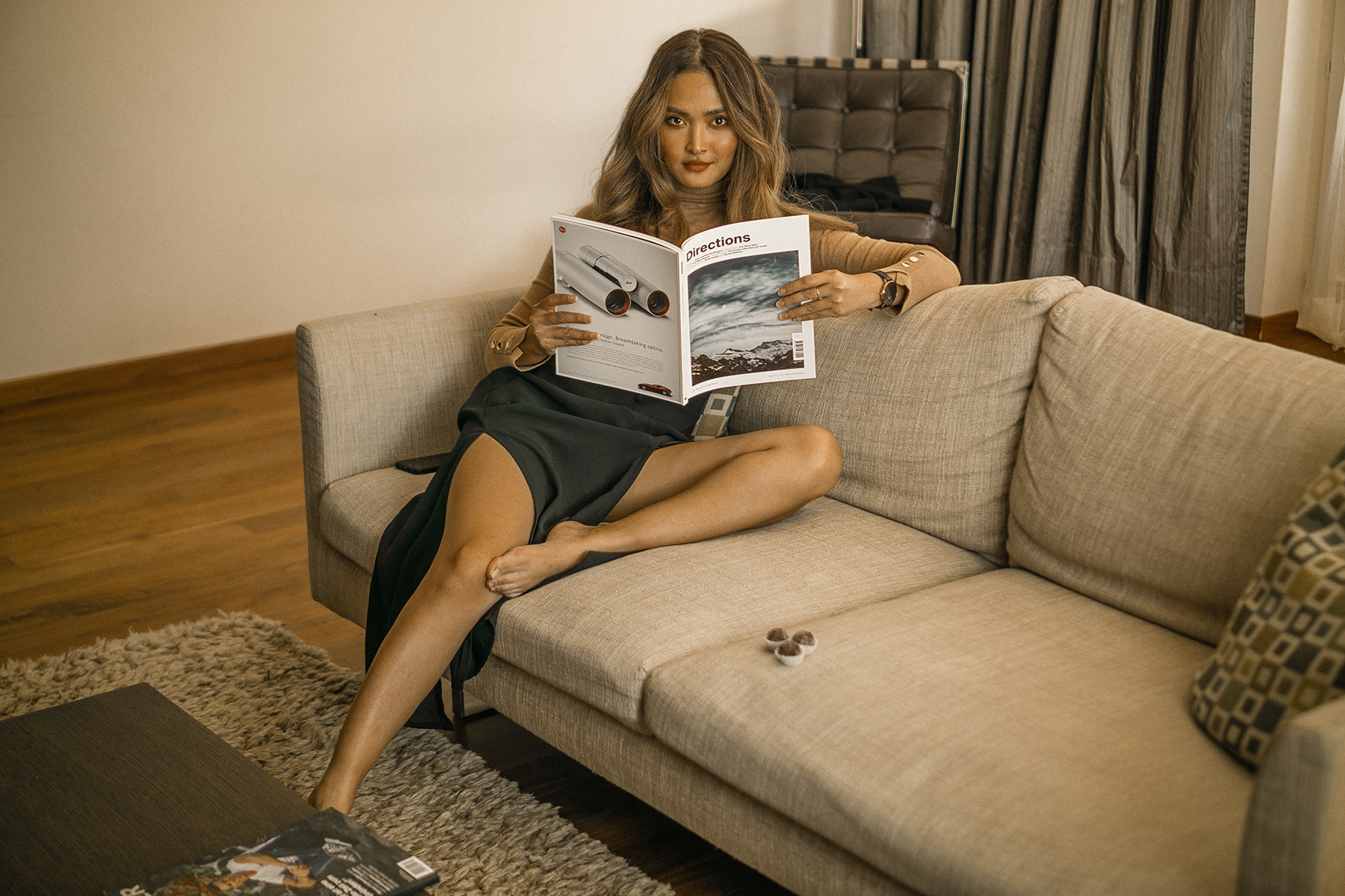 Reading a magazine on the sofa in our suite