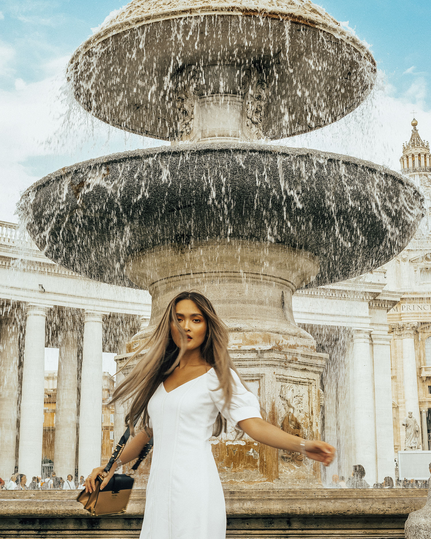 In front of the fountain at Vatican Square