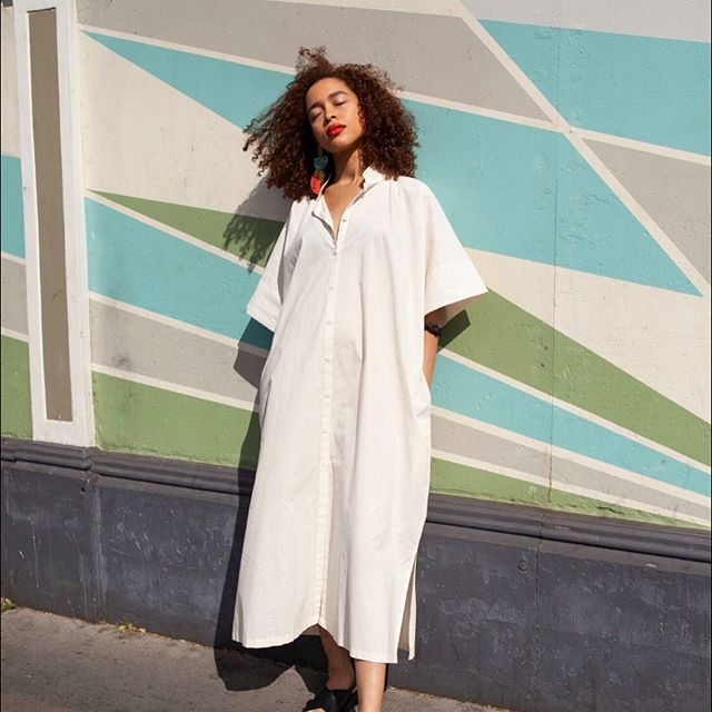 It't hot out there! We want our women to feel graceful, cool, comfortable and free. Our Allie Shirt does all of these things. In 💯% raw, unbleached cotton, this is a perfect all year round piece worn as a shirt dress, shirt jacket over a dress or even over trousers.  Named after and inspired by my oldest friend. Clothes should be investments, timeless, seasonless, multifunctional and provoke positive emotion.... just like the bestest of friends. @alliebarker81  Model @graceacladna 📷 @ayceeariel  Earrings available @arlette_gold . . . #versatileclothing #consciousclothing #responsiblefashion #wardrobestaples #seasonless #loveclotheslast #brandwithastory #womenwhoinspirewomen #womenwhoempowerwomen #craft #pieceofindoi #indoicraft #indoifamily #indoiwomen