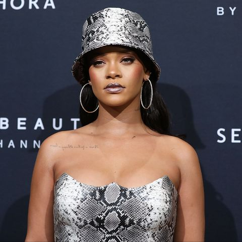 Rihanna, pictured here wearing a silver snakeskin dress and matching bucket hat, is the perfect artist to usher in a new era of luxury.