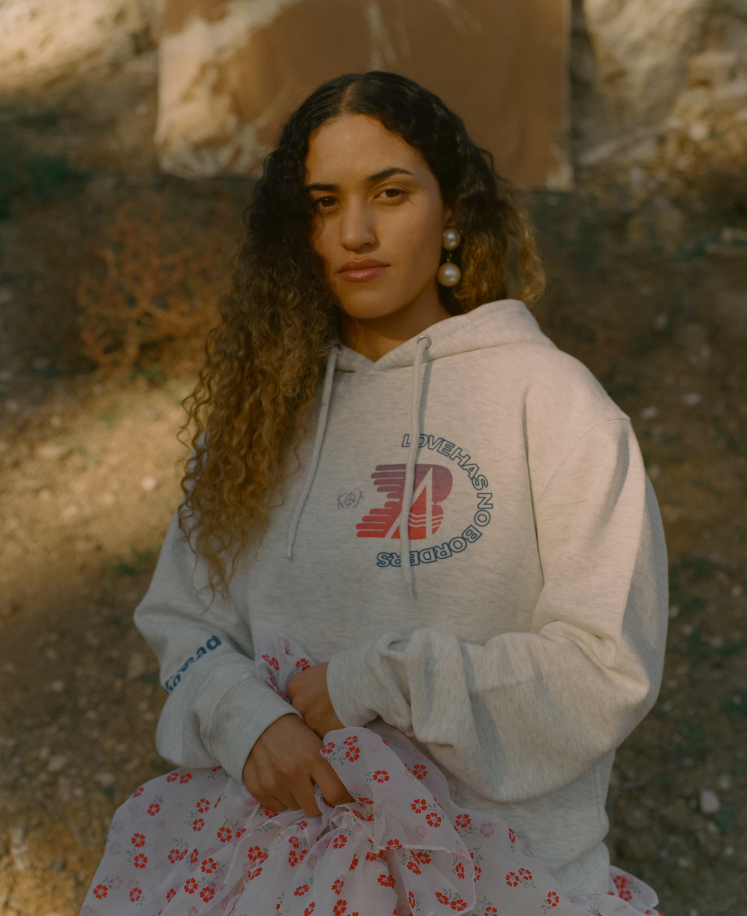 Musician Empress Of stars in the campaign for the Kids of Immigrants x Border Angels hoodie. One hundred percent of the sales will be donated to help migrants in shelters at the U.S.-Mexico border.