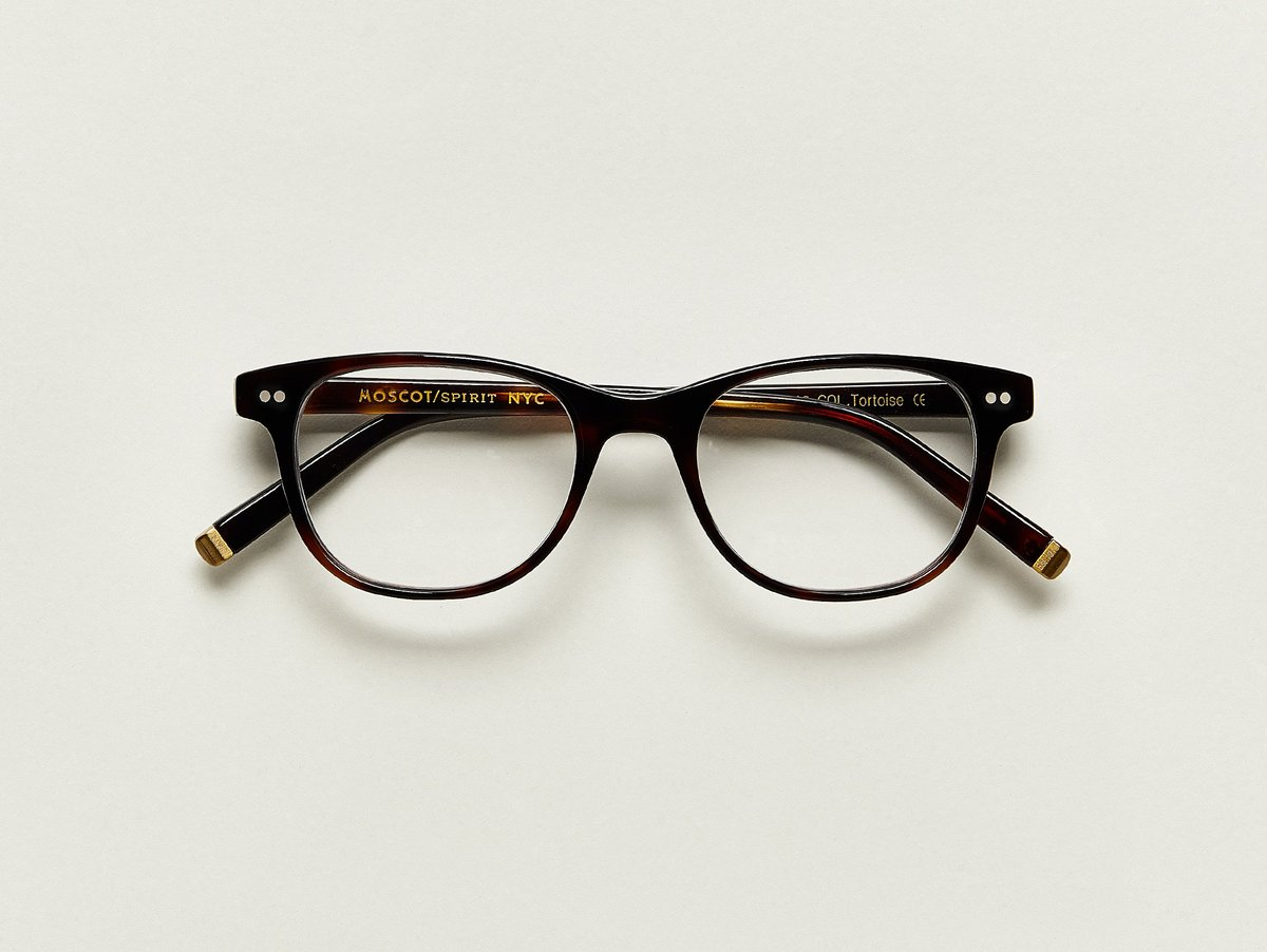 MOSCOT - Jesse Opticals  £245  COLOUR Tortoise  SIZE 48  A little bit square and a little bit round, The JESSE fits most faces effortlessly – so effortlessly you'll feel like you're Putting on your favorite pair of jeans... only on your face.  Handcrafted using Italian acetate featuring unique patterns distinctive to each frame  Features two dot rivets  Comfortable saddle nose bridge  Includes acetate nose pads  3-Barrel hinge  MOSCOT temple engravings  Signature brass temple tips for MOSCOT SPIRIT frames