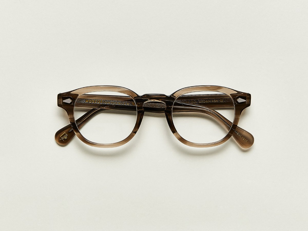 MOSCOT - Lemtosh Opticals  £245  COLOUR Brown Ash  SIZE 44  This rounder number has served as the calling card for generations of creative, thoughtful, free-spirited intellectuals and artistes – from James Dean to Johnny Depp.  Handcrafted using Italian acetate featuring unique patterns distinctive to each frame  Features diamond rivets  Comfortable key hole nose bridge  Includes acetate nose pads  7-Barrel hinge  MOSCOT temple engravings  Signature acetate tips