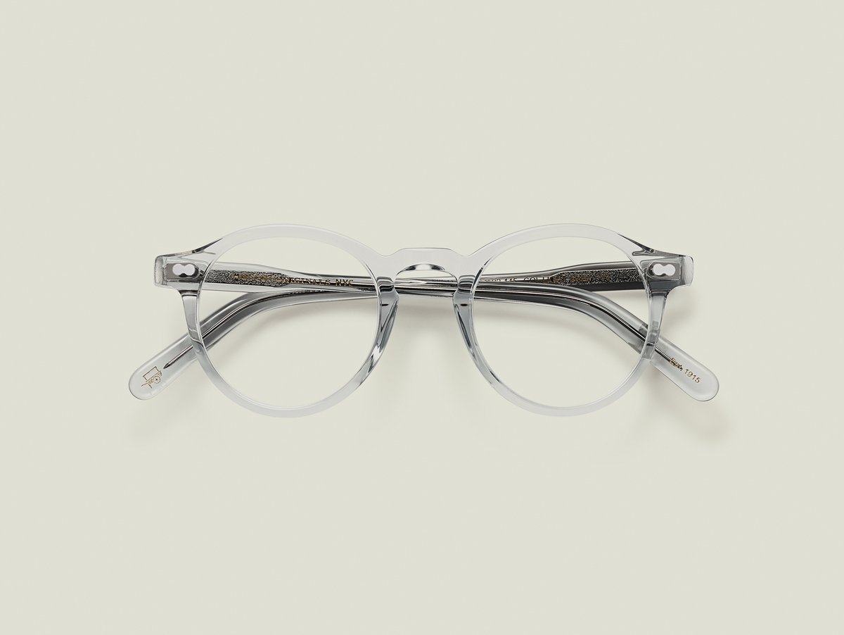 MOSCOT - Militzen Opticals  £245  COLOUR Light Grey  SIZE 44  The round, full-vue MILTZEN, first introduced in the 1930s, is eponymously named for our Uncle Heshy, who inexplicably everyone called Uncle Miltzen. And it stuck. So there you go, world... The MILTZEN.  Handcrafted using Italian acetate  Features adjoined dot rivets  Comfortable key hole nose bridge  Includes acetate nose pads  3-Barrel hinge  MOSCOT temple engravings