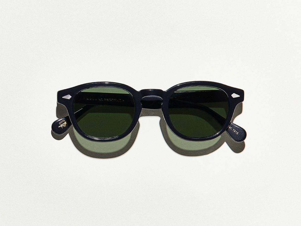 MOSCOT - Lemtosh Sunglasses  £265  COLOUR Black  SIZE 46  This rounder number has served as the calling card for generations of creative, thoughtful, free-spirited intellectuals and artistes – from James Dean to Johnny Depp.  Handcrafted using Italian acetate featuring unique patterns distinctive to each frame  Features diamond rivets  Features real glass lenses in G-15