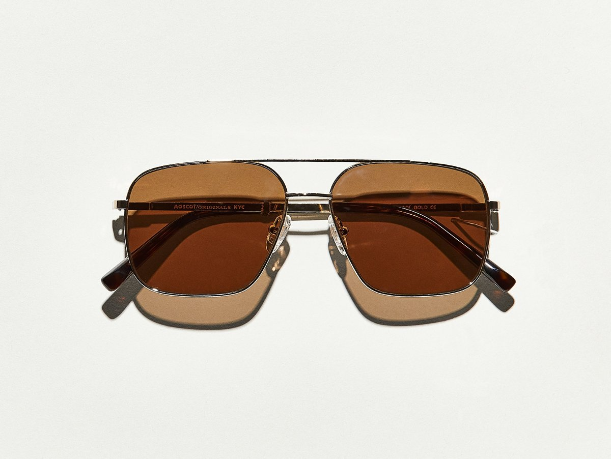 MOSCOT - Shtarker Sunglasses  £265  COLOUR Gold  SIZE 57  No matter what type of empire you sit atop of, you'll project an air of strength that says you're not to be trifled with...even if you're just leader of the pack.  Handcrafted using metal  Comfortable double bar nose bridge  Includes silicone nose pads  MOSCOT temple engravings  Signature acetate tips  Unisex