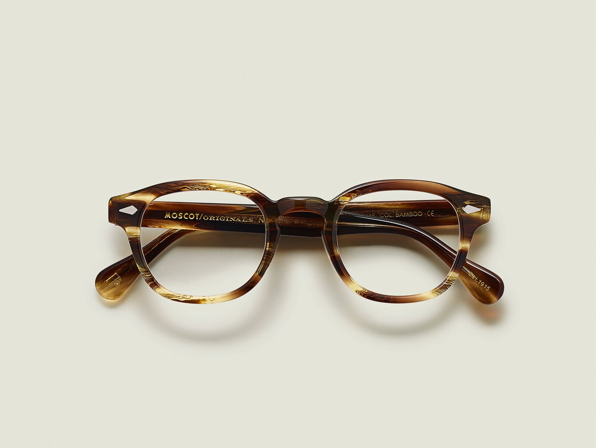 MOSCOT - Lemtosh  £245  COLOUR Bamboo  SIZE 46  This rounder number has served as the calling card for generations of creative, thoughtful, free-spirited intellectuals and artistes – from James Dean to Johnny Depp.  Handcrafted using Italian acetate featuring unique patterns distinctive to each frame  Features diamond rivets  Comfortable key hole nose bridge  Includes acetate nose pads  7-Barrel hinge  MOSCOT temple engravings  Signature acetate tips