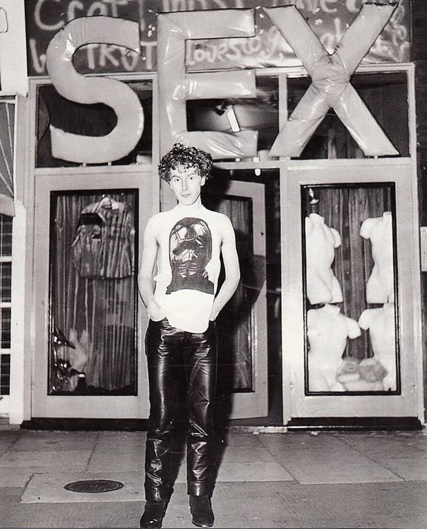Malcolm McLaren standing in front of his famous shop SEX.