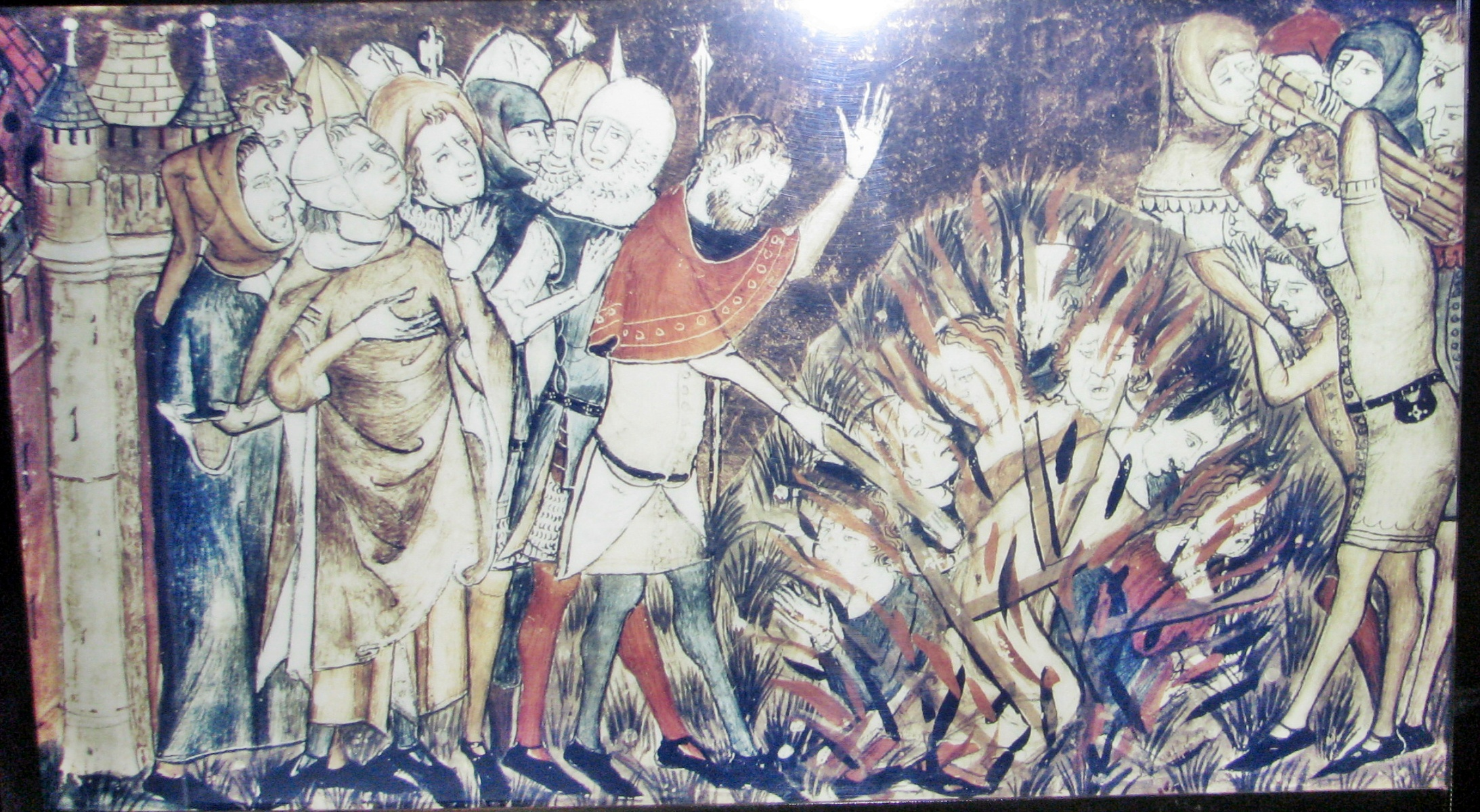 Jews being burned at the stake. Miniature from a 14th-century manuscript.