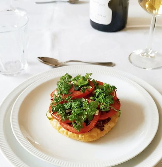 The starter for spring is a fresh tomato gallete with olive tapenade, goatcheese, topped with a green herb crown, fresh from our garden. Light but filling and crisp. . . #eeeeeats #chefsofinstagram #starter #spring #dinner #feedfeed #food52 #catering #local #parmigiano #utrecht #rotterdam #haarlem #nederland #lokaal #indebuurt
