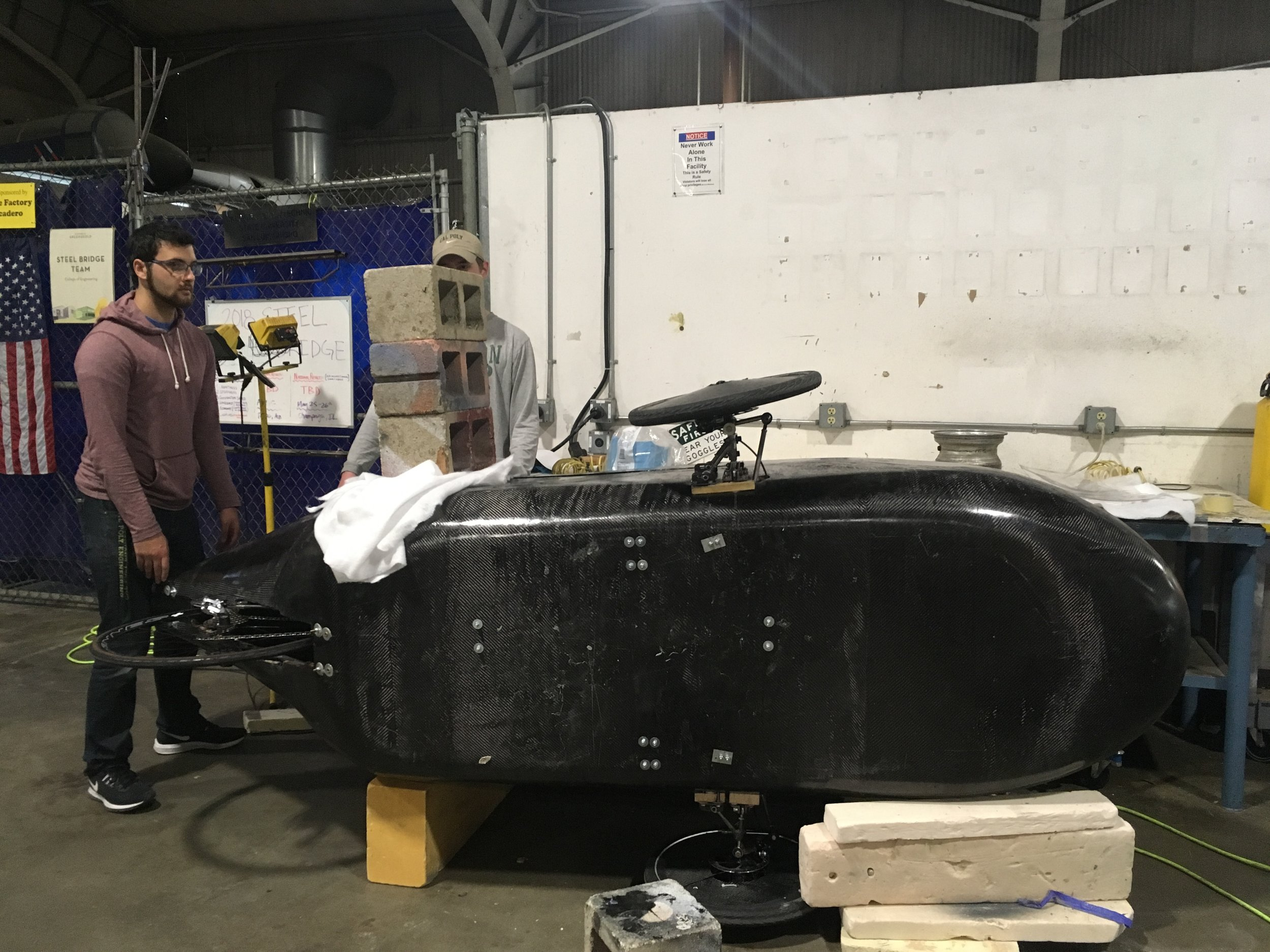 Stress testing on the roll bar…and it holds up! We tested with over  100  pounds of stress.
