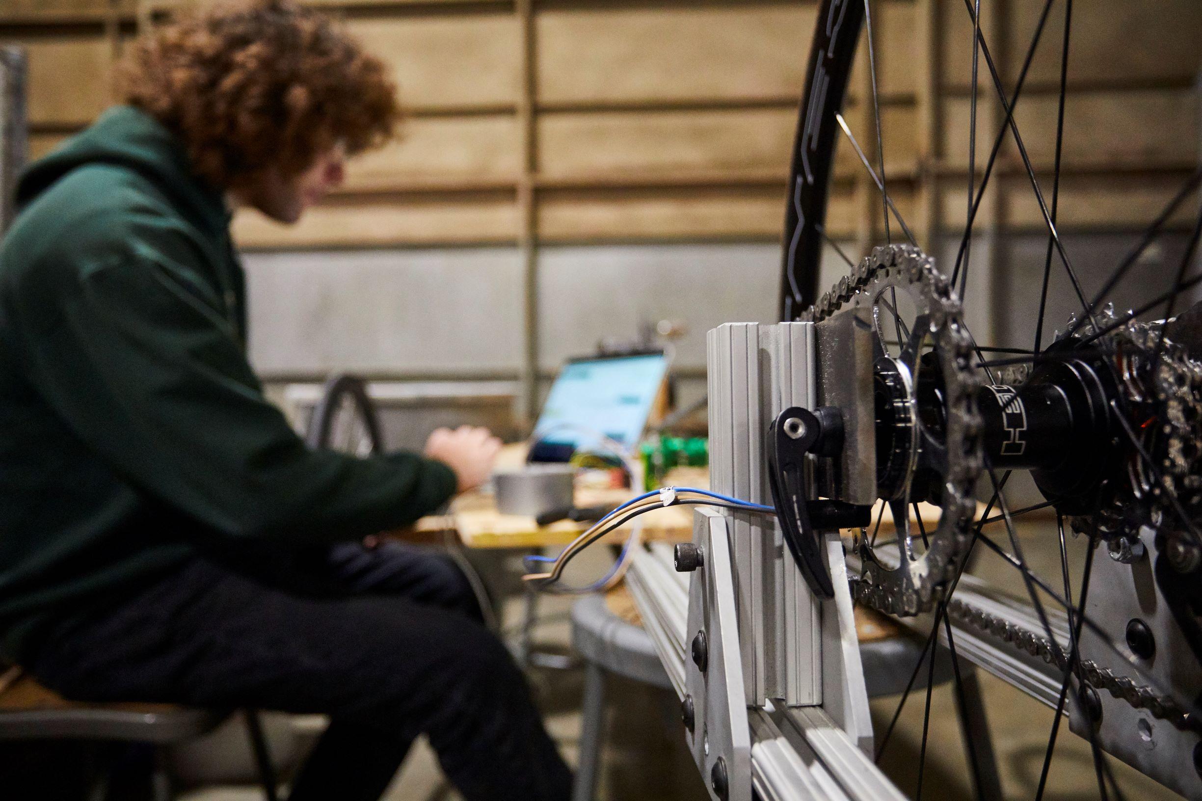 Sam Porter, who designed the reverse gear mechanism, runs tests on the prototype bike.