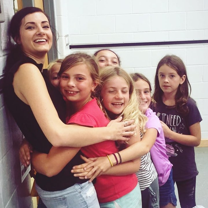 Students Giveing Elsie a Hug.jpg