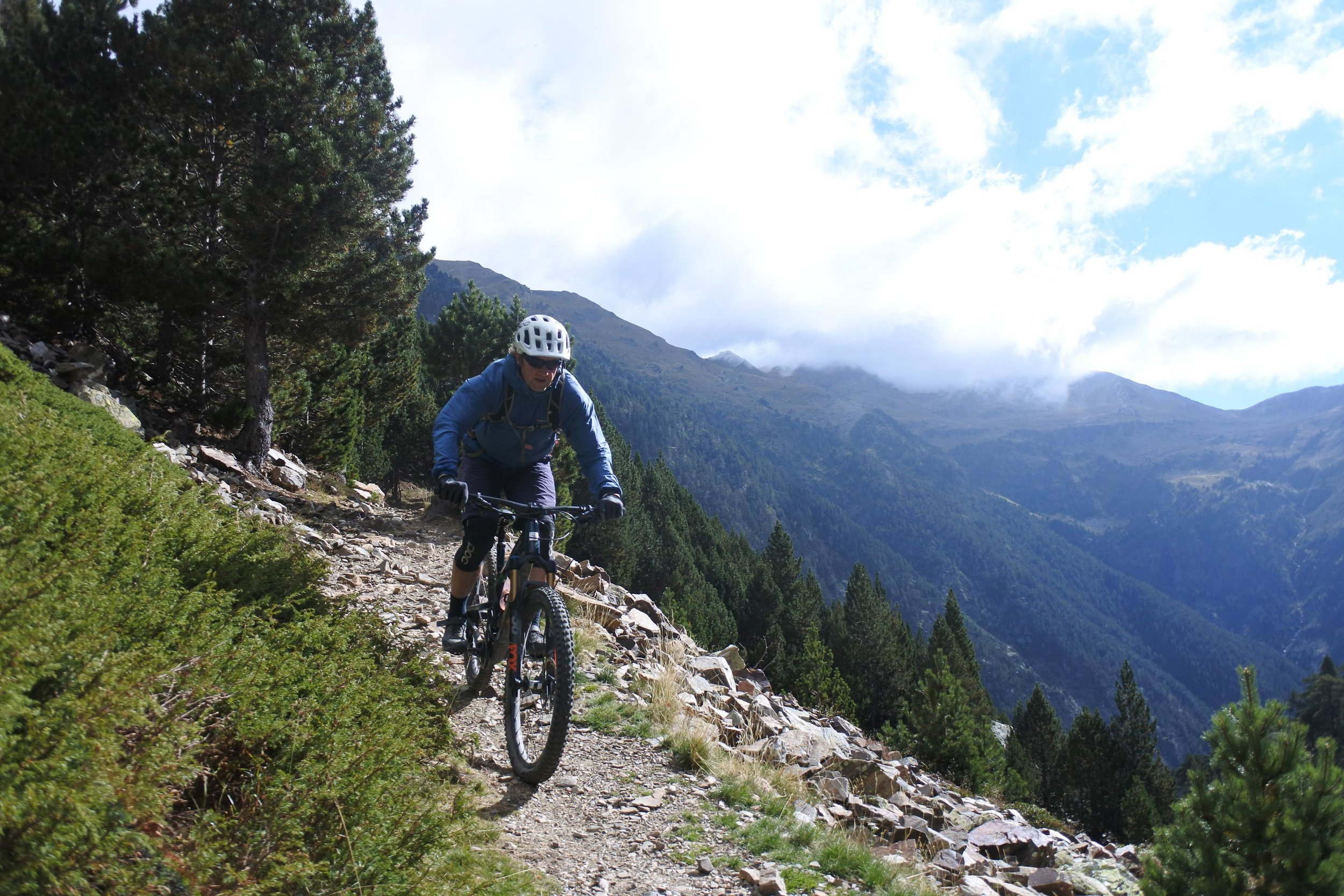 Mark riding down some alpine trails near the French border